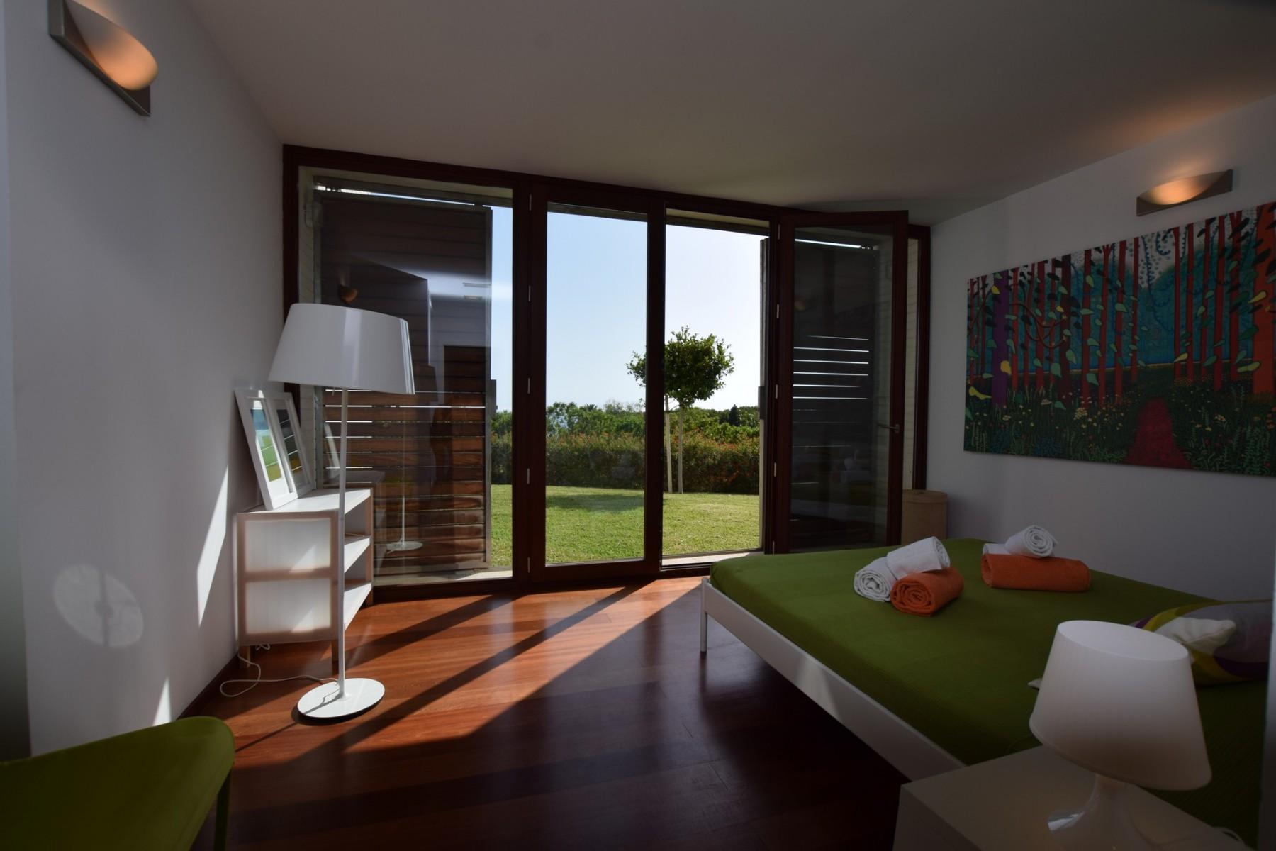 Atlántico IV - Dormitorio doble 4 - acceso al jardín